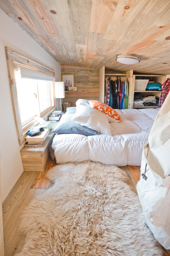 Bedroom - contemporary light wood floor bedroom idea in San Francisco with white walls