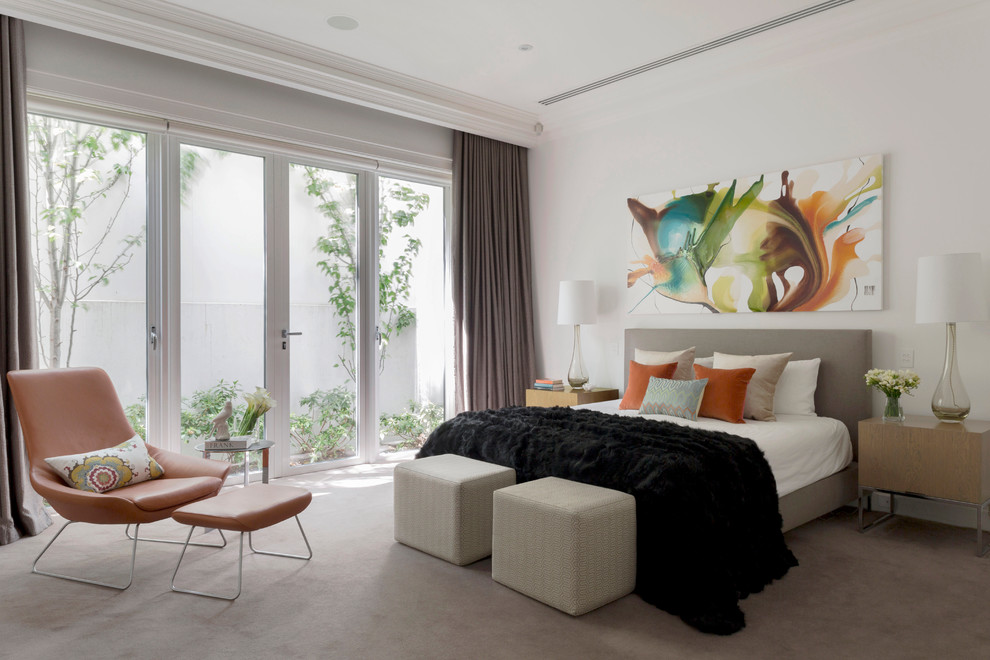 Example of a trendy carpeted bedroom design in Melbourne with white walls and no fireplace