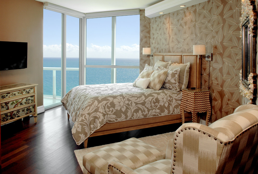 Inspiration for a large tropical guest bedroom remodel in Miami with brown walls and no fireplace