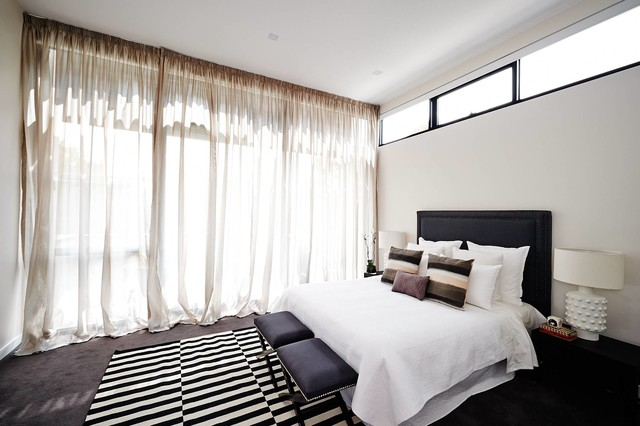 mid sized trendy carpeted bedroom photo in melbourne with white walls - Luxury Modern Bedroom