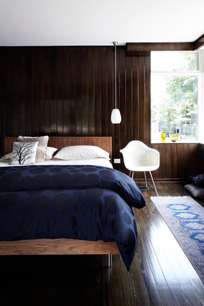 Mid-sized 1950s dark wood floor bedroom photo in Melbourne with brown walls
