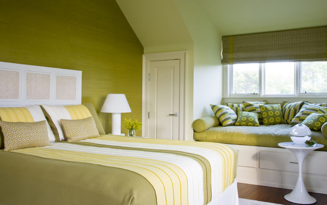Example Of A Clic Medium Tone Wood Floor Bedroom Design In New York With Green Walls