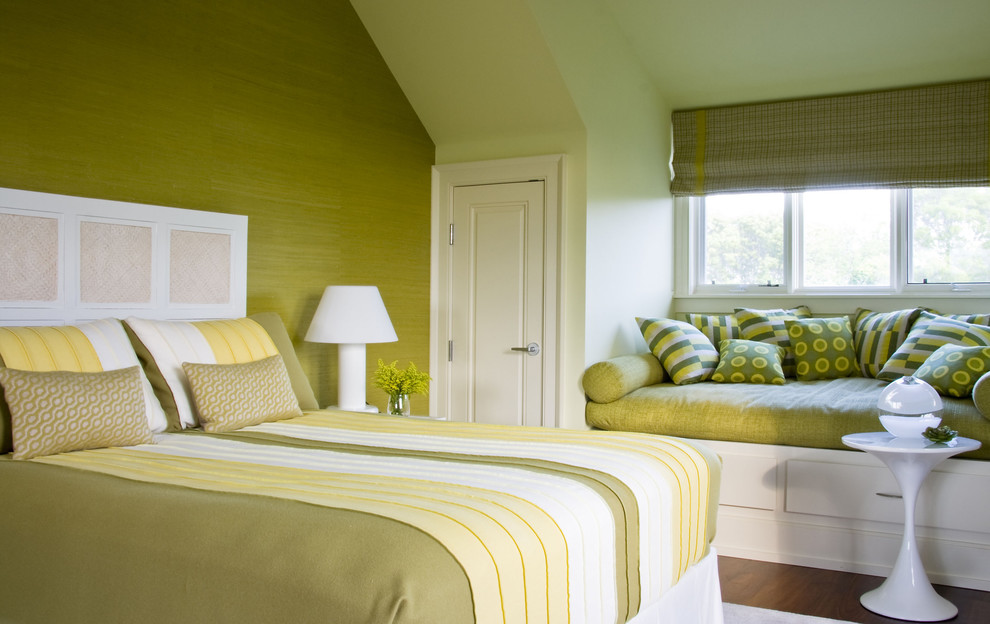 Example of a classic medium tone wood floor bedroom design in New York with green walls