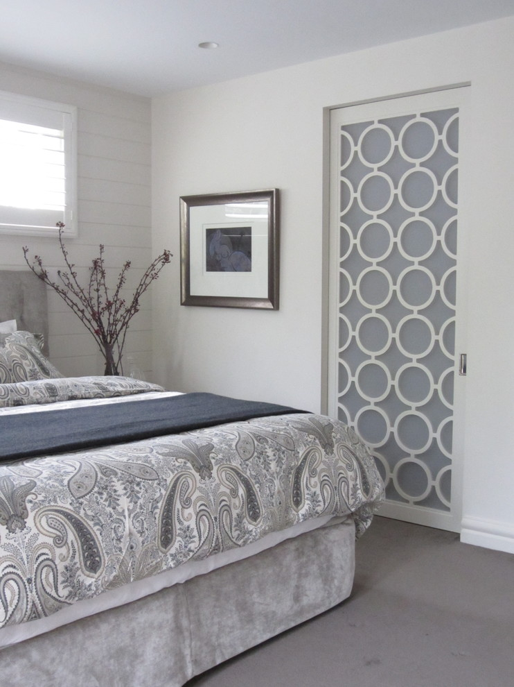 Elegant carpeted bedroom photo in Sydney with white walls