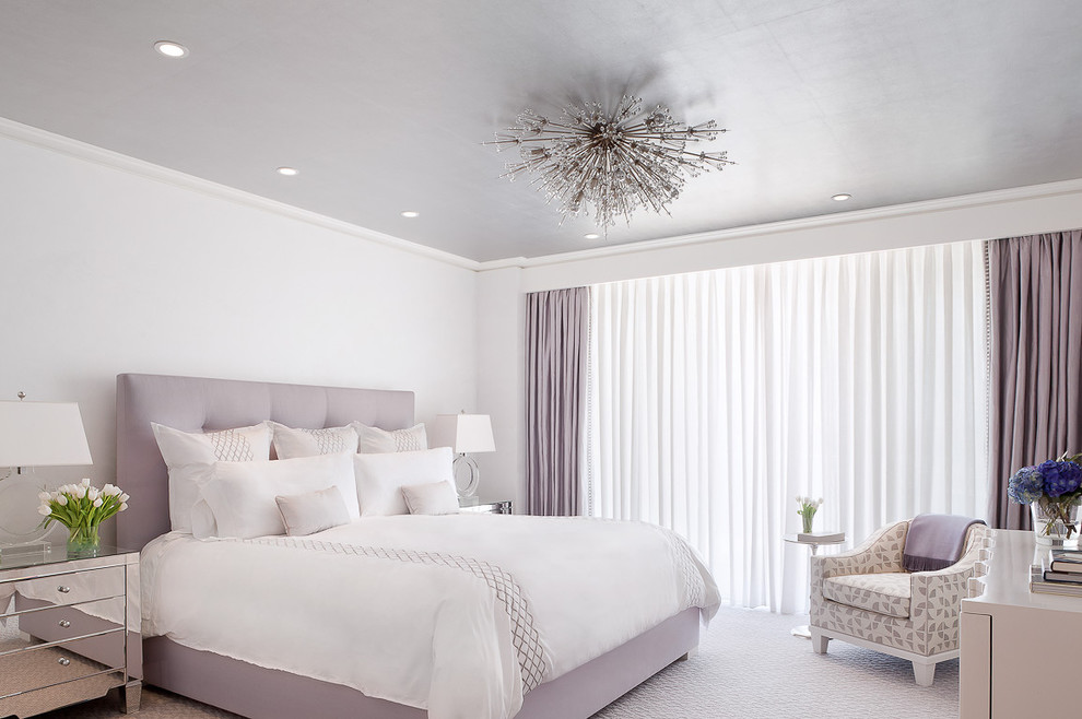 Elegant carpeted bedroom photo in New York with white walls and no fireplace
