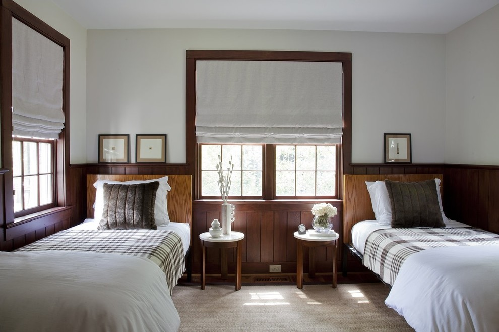 Example of a classic guest bedroom design in New York with white walls