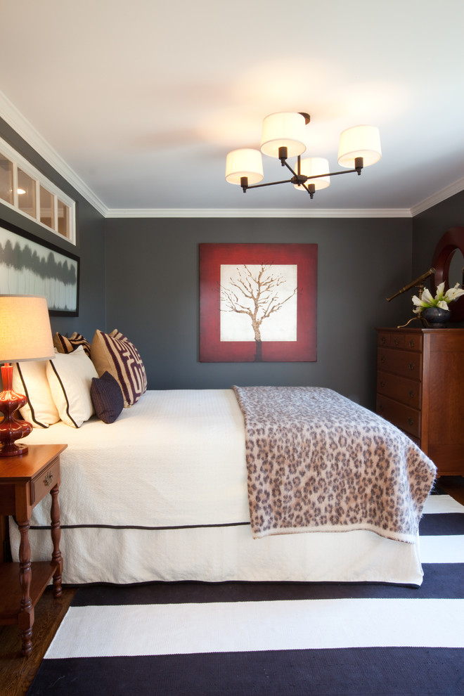 Inspiration for a mid-sized timeless master dark wood floor and brown floor bedroom remodel in Other with gray walls and no fireplace