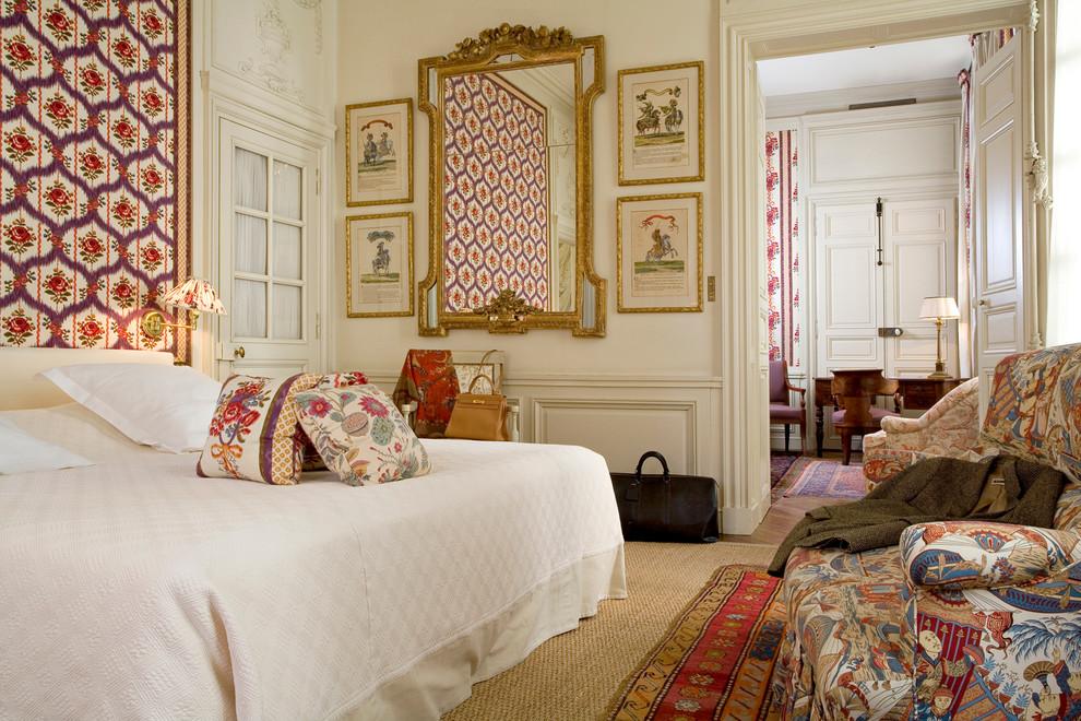 Bedroom - traditional medium tone wood floor bedroom idea in Charleston with beige walls