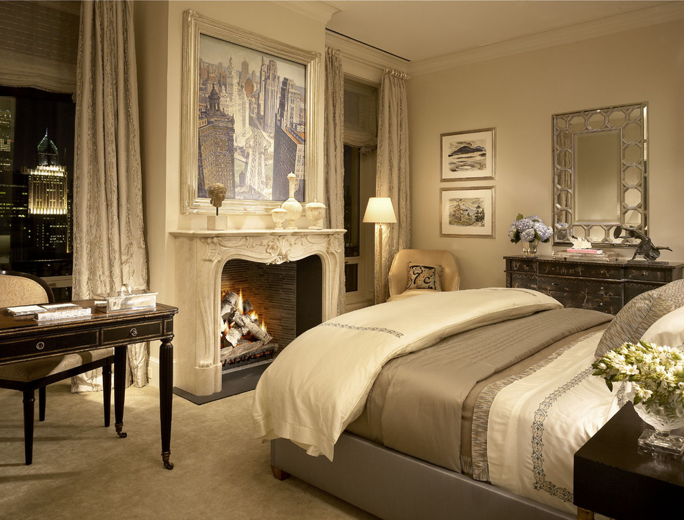 Inspiration for a timeless carpeted bedroom remodel in Other with beige walls and a standard fireplace