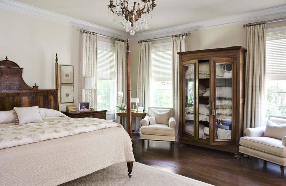 Example of a cottage chic dark wood floor bedroom design in Charleston with beige walls