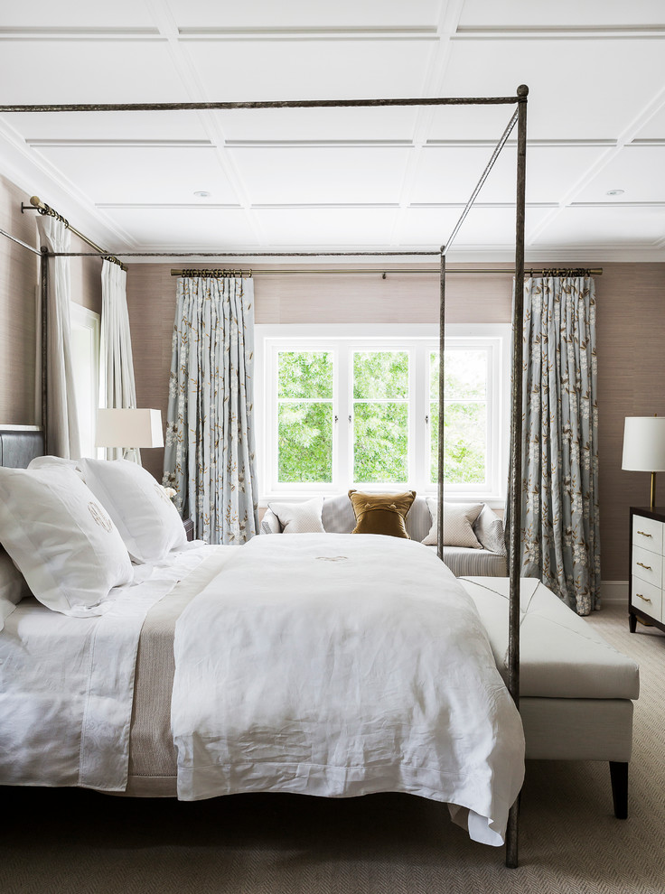 This is an example of a traditional master bedroom in Sydney with grey walls and carpet.