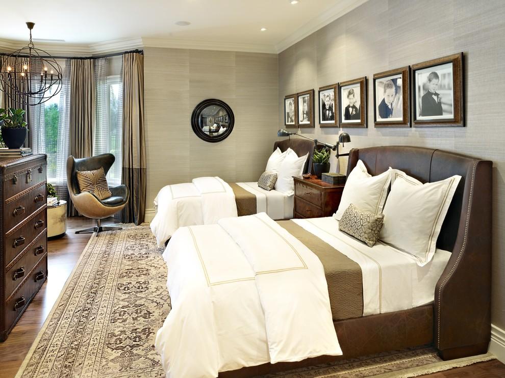 Elegant medium tone wood floor bedroom photo in Las Vegas with gray walls