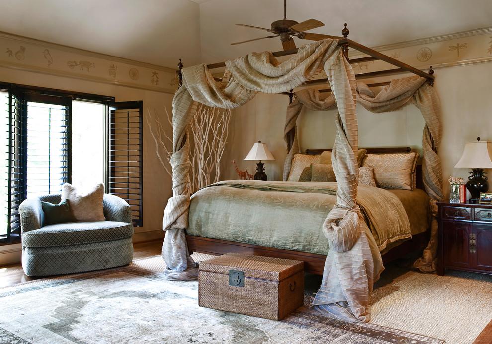 Bedroom - traditional master medium tone wood floor and brown floor bedroom idea in Other with beige walls