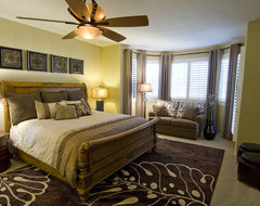 Traditional furnishings translated to a transitional look eclectic bedroom