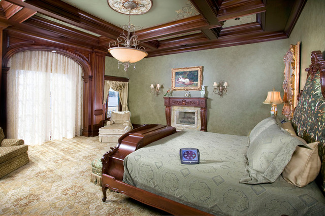green bedroom with wood wall trim moulding mediterranean bedroom