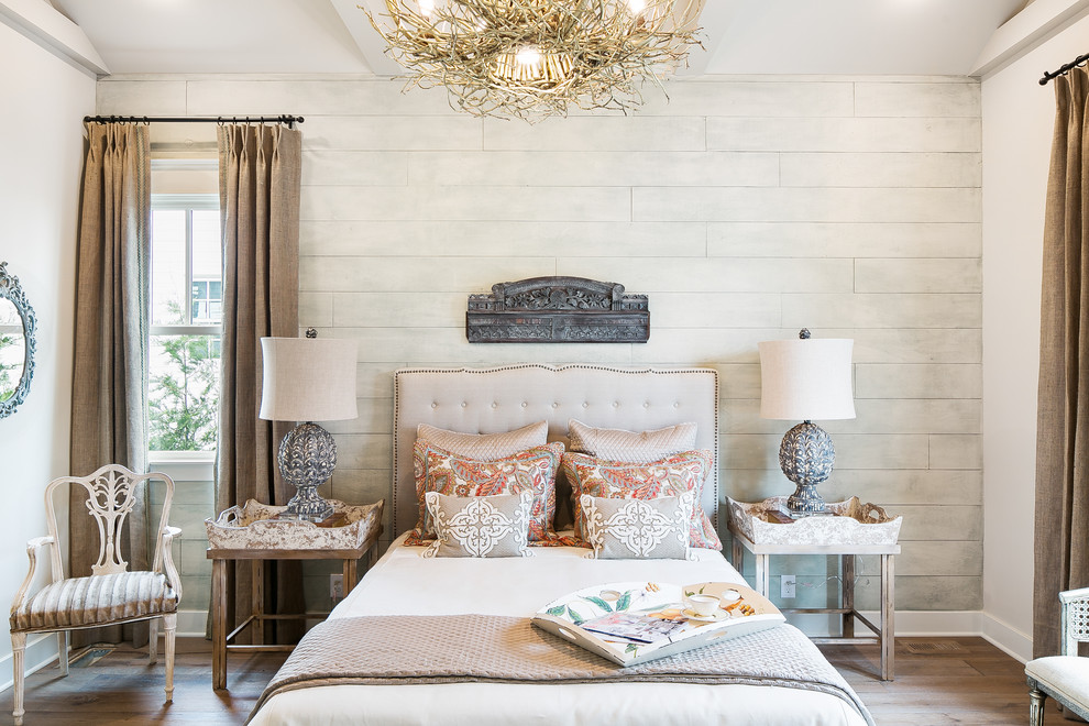 Example of a country master light wood floor bedroom design in Louisville with white walls