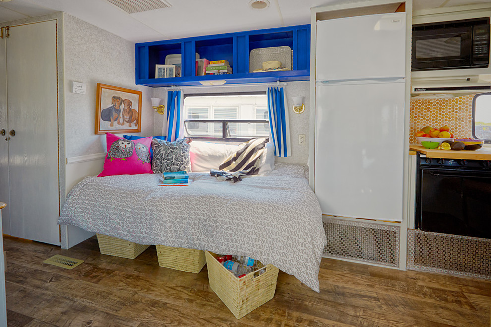 Small eclectic medium tone wood floor bedroom photo in Philadelphia with multicolored walls and no fireplace
