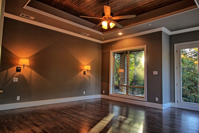 Example of a transitional bedroom design in Dallas
