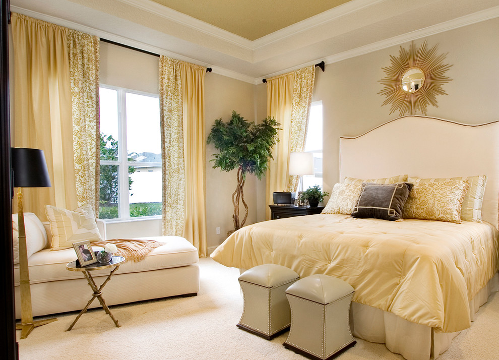 Transitional carpeted bedroom photo in Orlando with beige walls