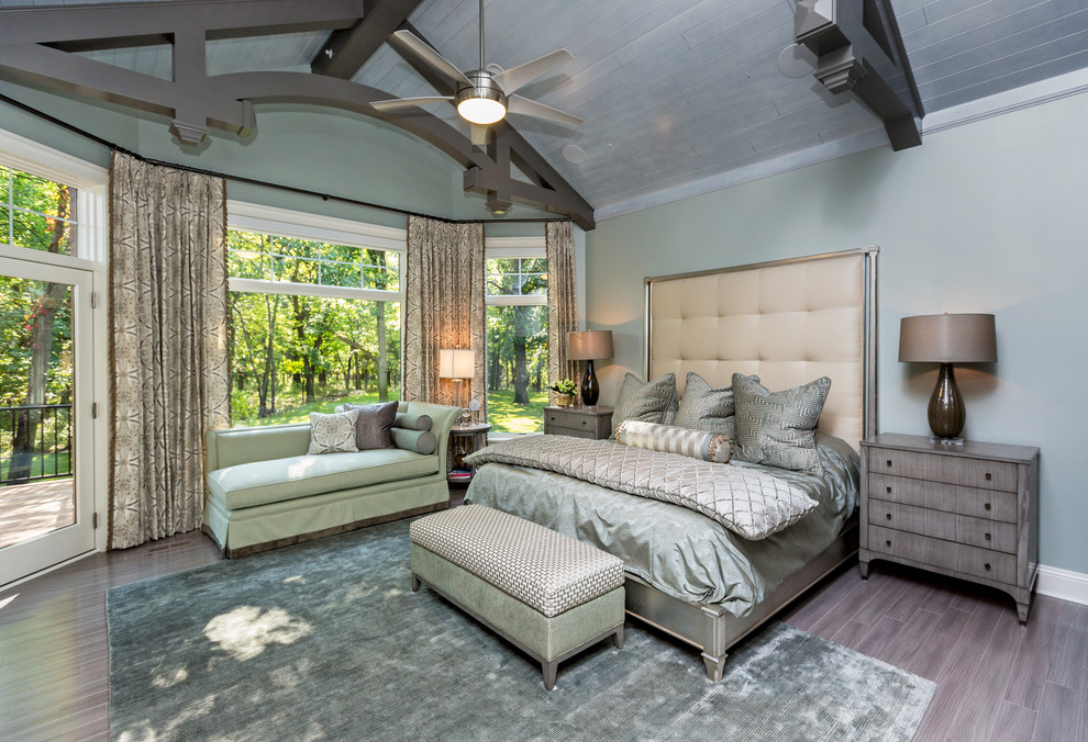 Example of a transitional bedroom design in Other with gray walls