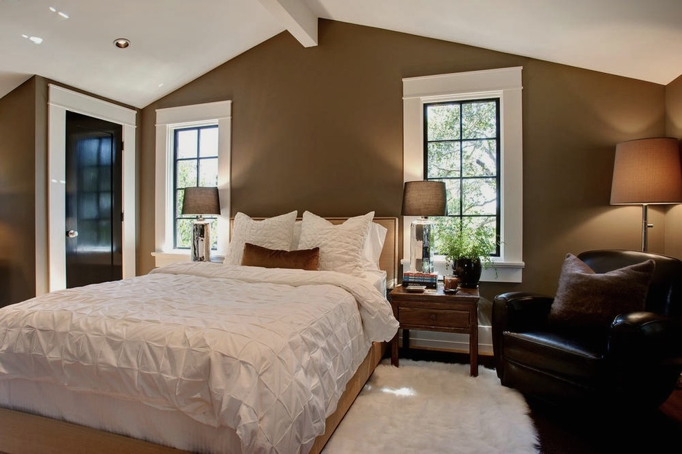 Example of a transitional bedroom design in San Francisco with brown walls