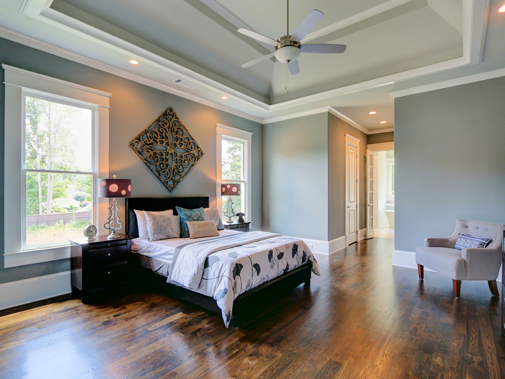 Inspiration for a mid-sized transitional master medium tone wood floor bedroom remodel in Atlanta with gray walls and no fireplace