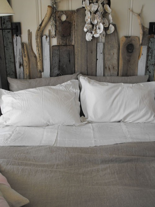 Driftwood and reclaimed wood headboard - what a beautiful focal point in a bedroom and easy DIY!