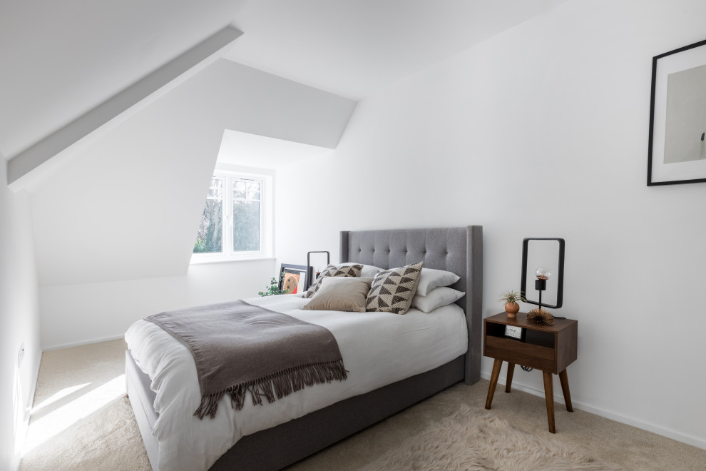 This is an example of a scandinavian bedroom in Sussex.