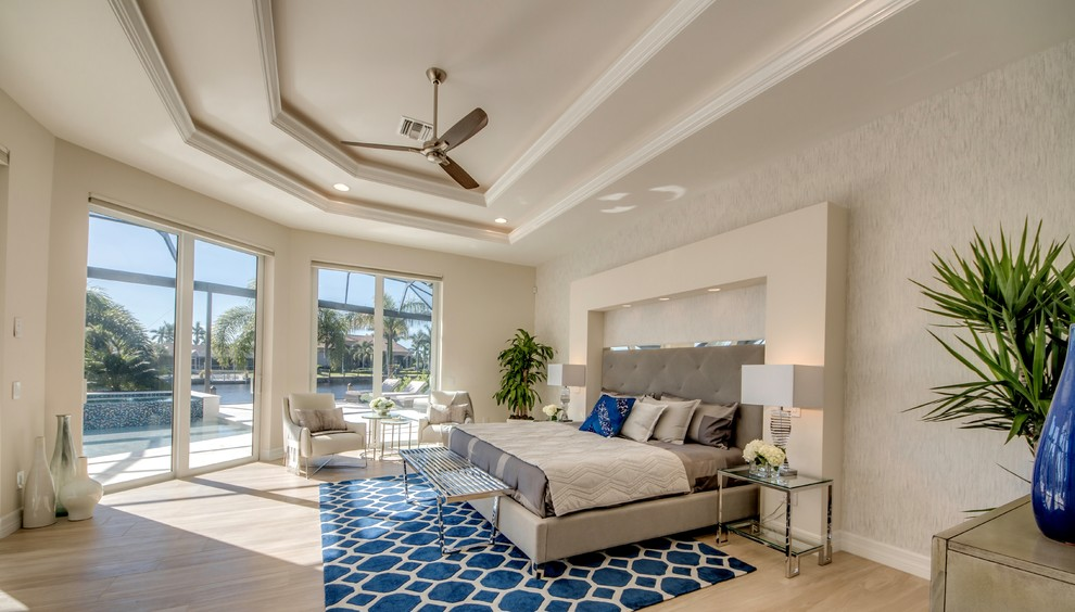 Inspiration for a mid-sized contemporary master porcelain tile and brown floor bedroom remodel with beige walls and no fireplace