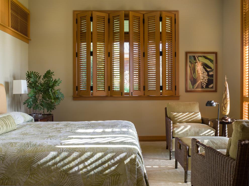Bedroom - tropical bedroom idea in Atlanta with beige walls