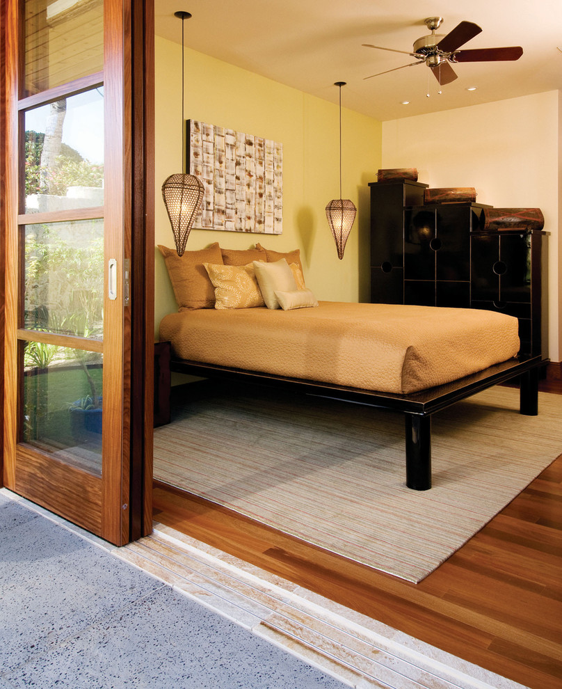 Example of an island style medium tone wood floor bedroom design in Hawaii