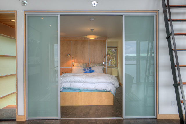Master bedroom with translucent doors open. beach-style-bedroom & Master bedroom with translucent doors open.