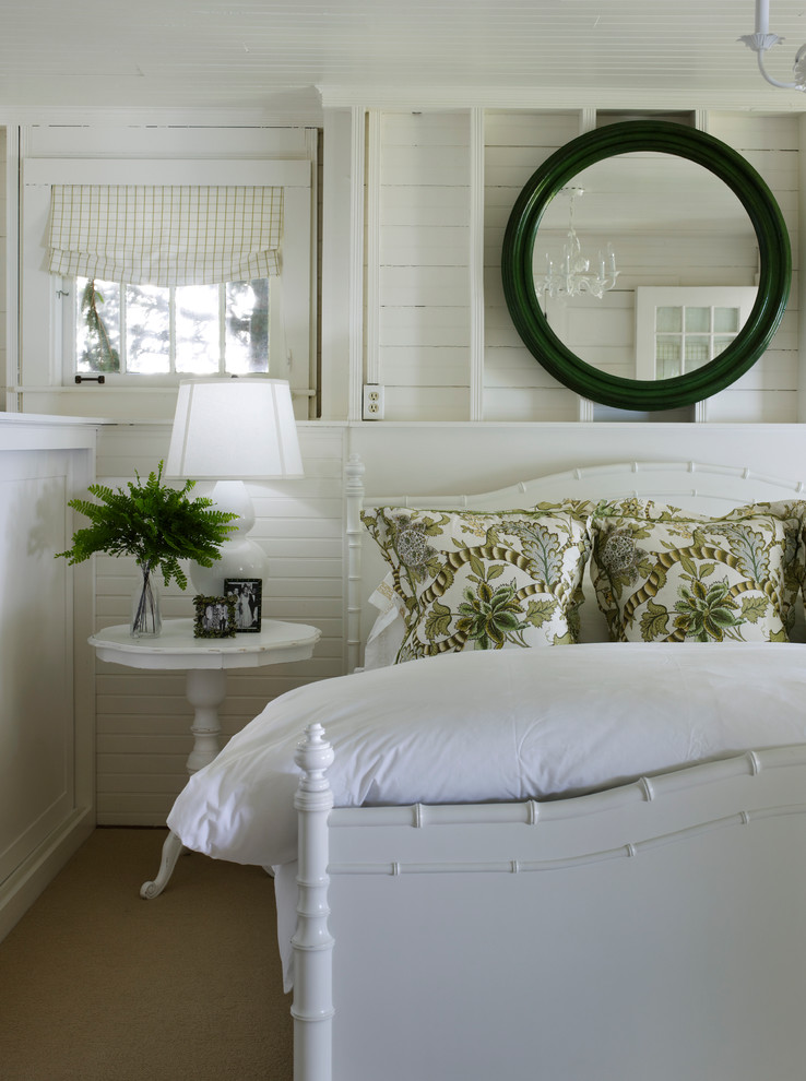 Example of a coastal carpeted bedroom design in Chicago with white walls