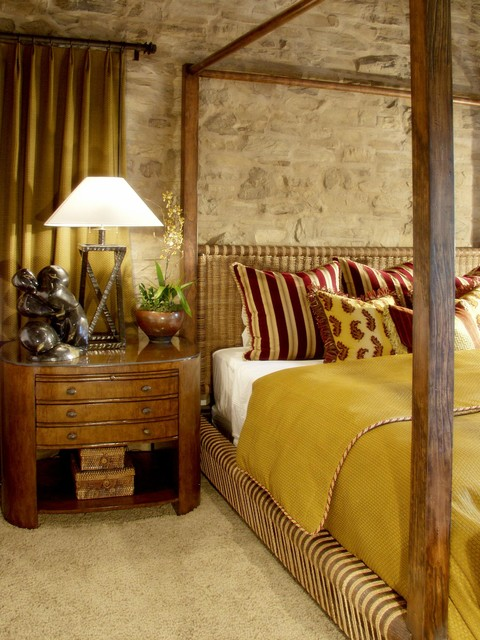 Tuscan Bedroom with Stone Accent Wall mediterranean-bedroom