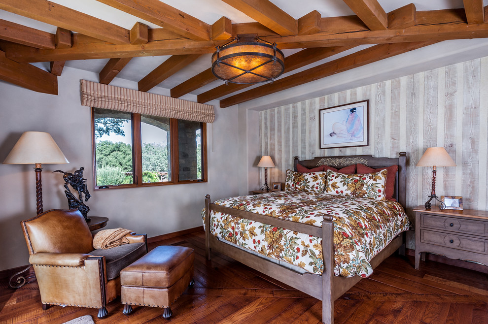 Large southwest guest dark wood floor and brown floor bedroom photo in San Diego with multicolored walls and no fireplace