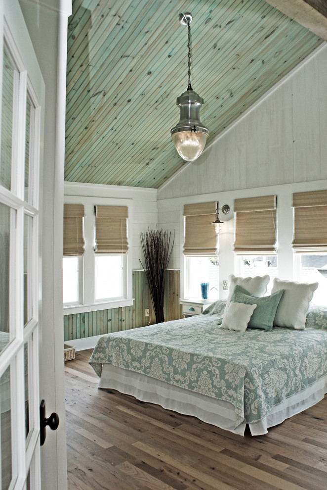 Beach style master light wood floor bedroom photo in DC Metro with multicolored walls