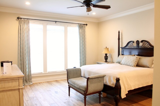 Bedroom - master light wood floor bedroom idea in Other with beige walls and no fireplace
