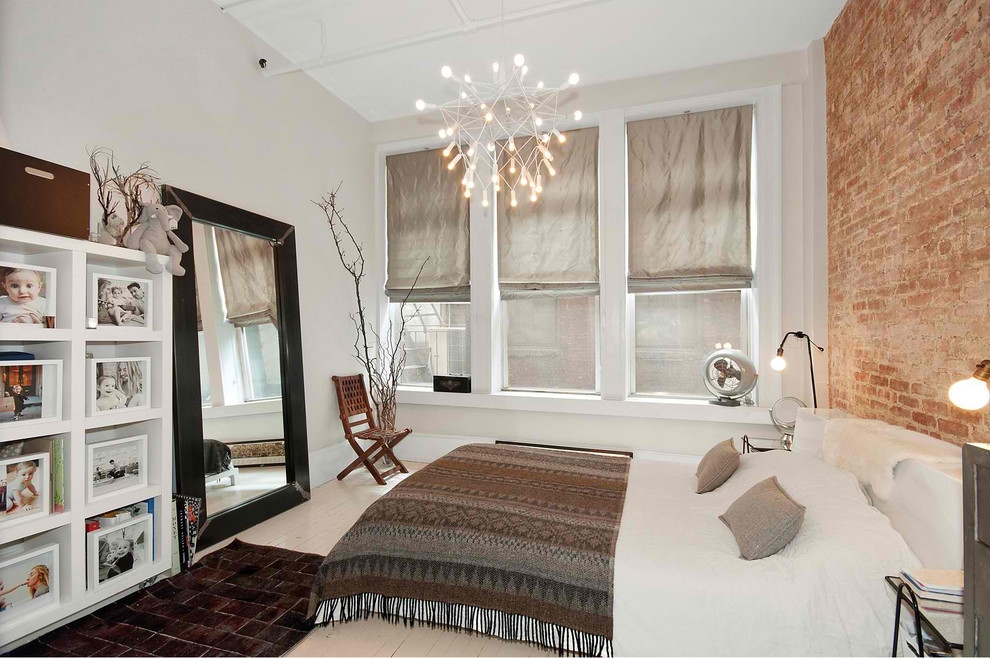 Example of a mid-sized minimalist master painted wood floor and beige floor bedroom design in New York with gray walls
