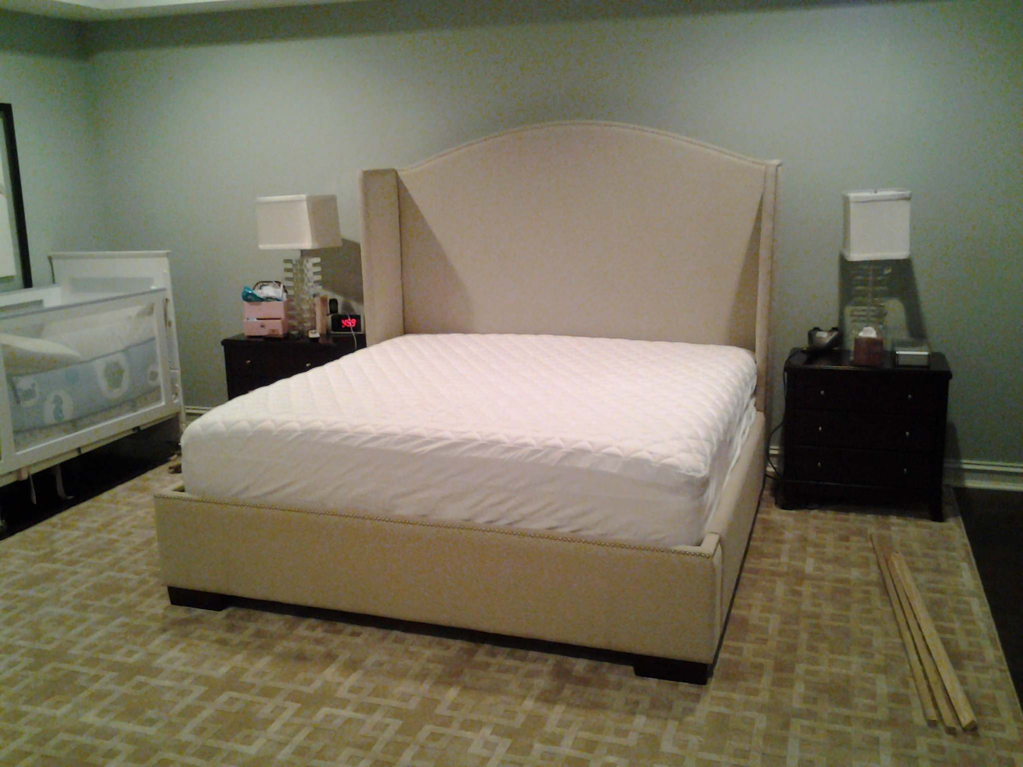 Upholstered bed with nail heads