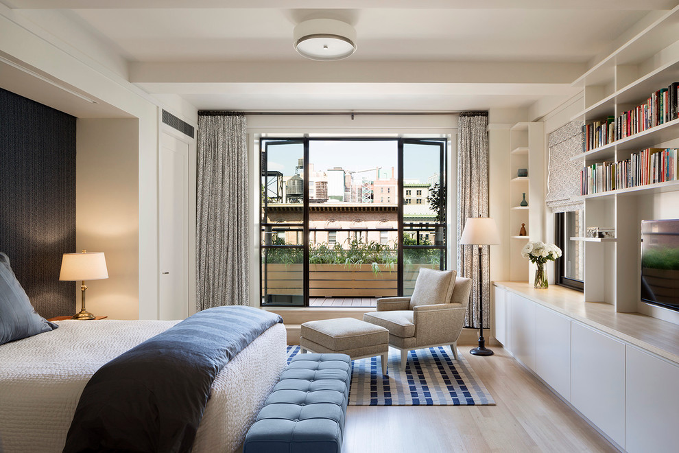 Mid-sized trendy master light wood floor bedroom photo in New York with white walls and no fireplace