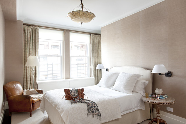 Trendy bedroom photo in New York with beige walls