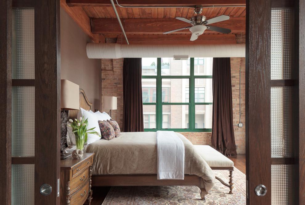Example of an urban dark wood floor and brown floor bedroom design in Denver with gray walls