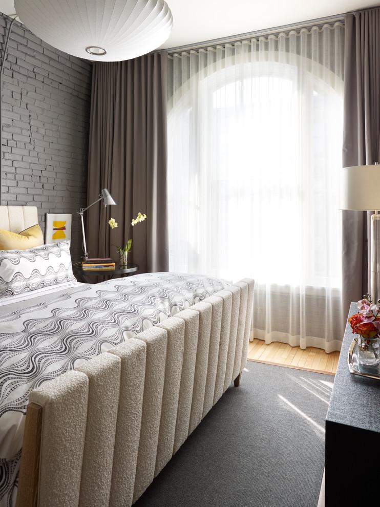 Trendy medium tone wood floor bedroom photo in Chicago with gray walls