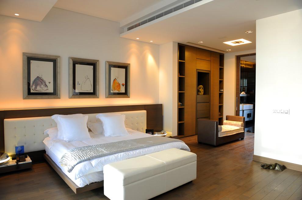 Bedroom - contemporary dark wood floor bedroom idea in Other with beige walls