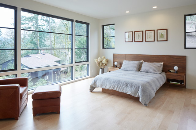 Mid-sized trendy master light wood floor and beige floor bedroom photo in Portland with white walls