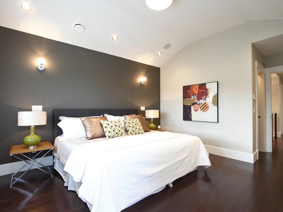 Example of a trendy dark wood floor bedroom design in Vancouver with gray walls