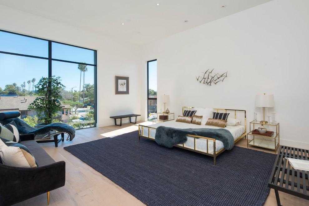 Bedroom - contemporary light wood floor bedroom idea in Los Angeles with white walls