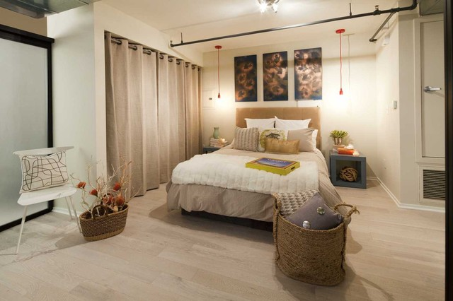 Great Eclectic Light Wood Floor Bedroom Idea In Los Angeles With Beige Walls
