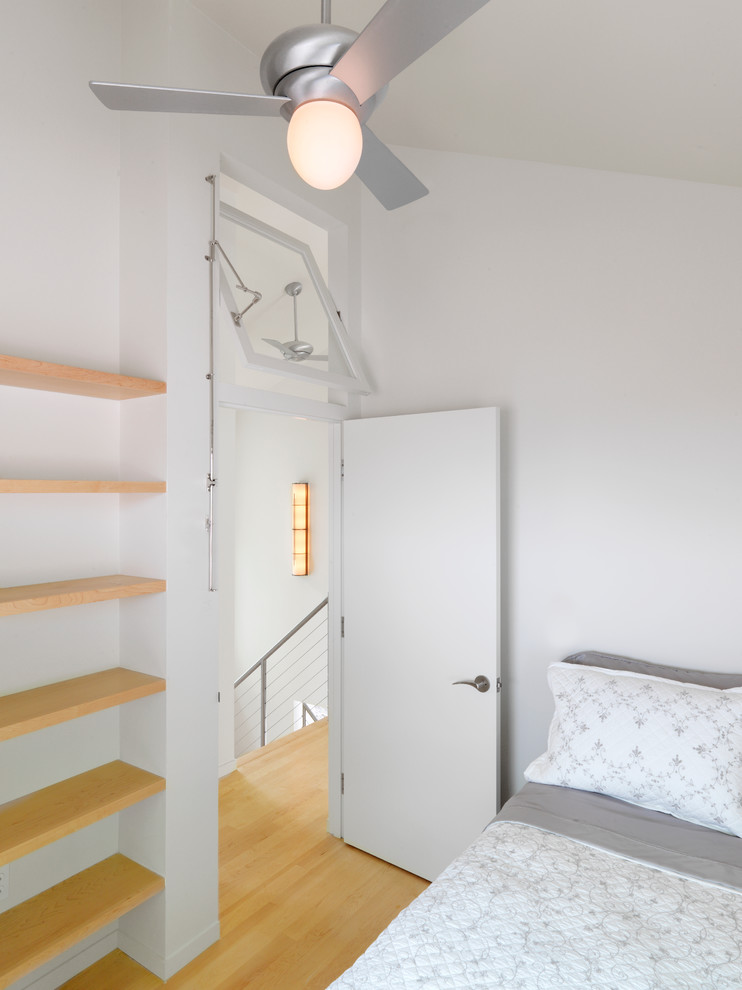 Inspiration for a contemporary bedroom remodel in Burlington with white walls