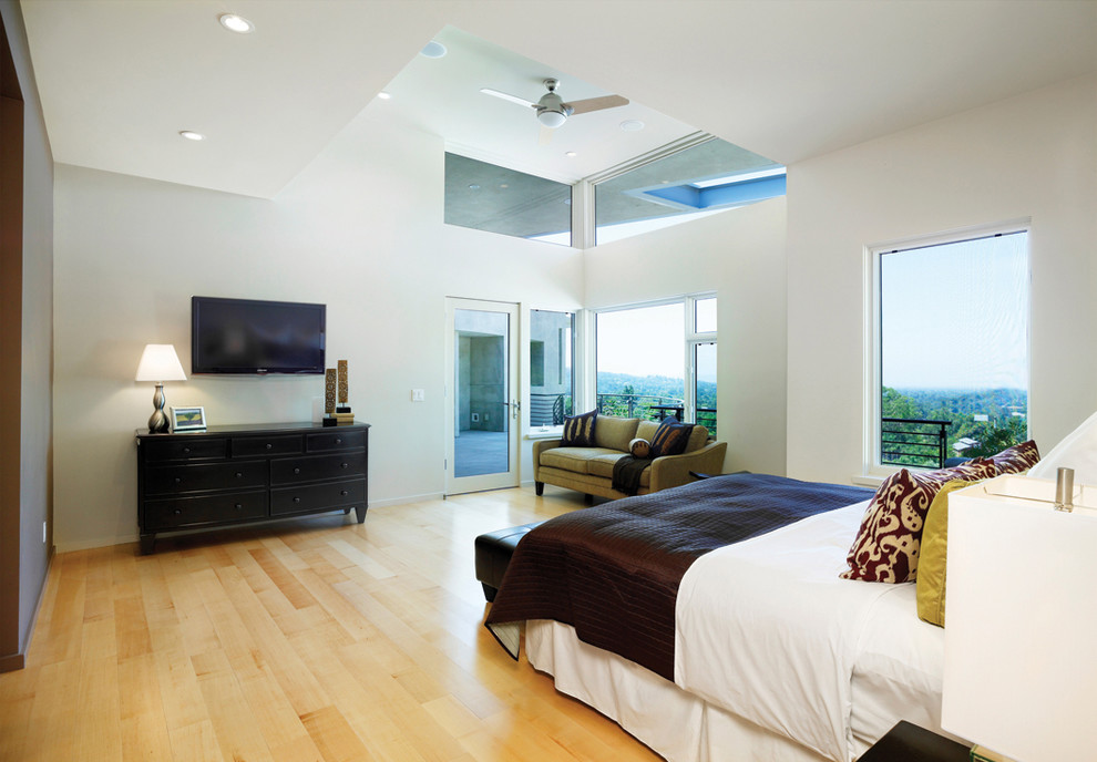 Example of a minimalist light wood floor bedroom design in Los Angeles with white walls
